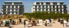 Strandkörbe und im Hintergrund das Seetelhotel Kaiserstrand Beachhotel